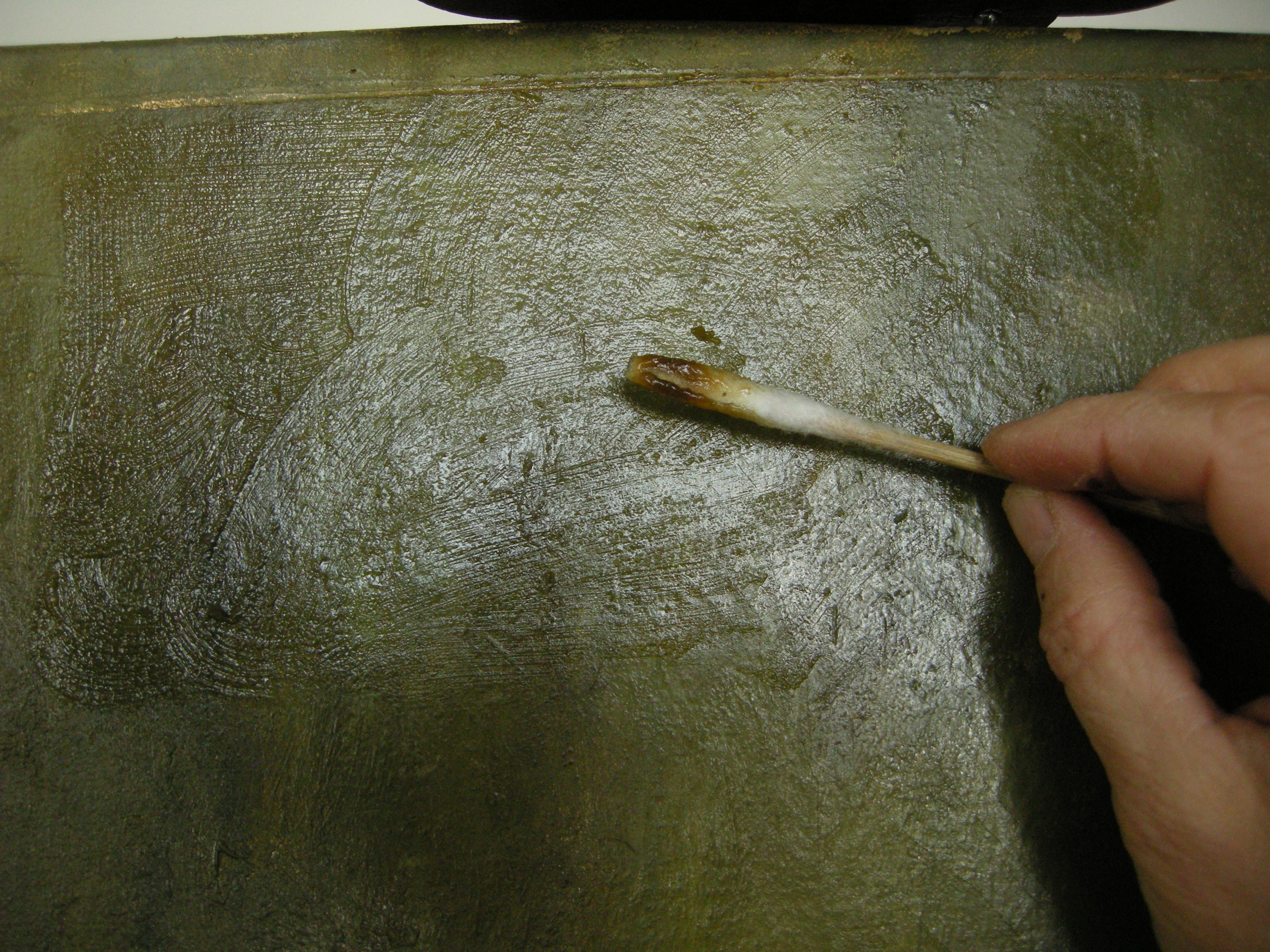 vernis van een schilderij verwijderen