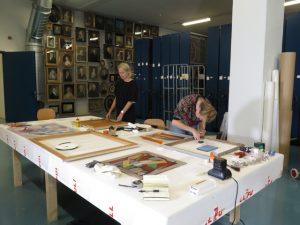 Marleen and Sjoukje re-fitting frames